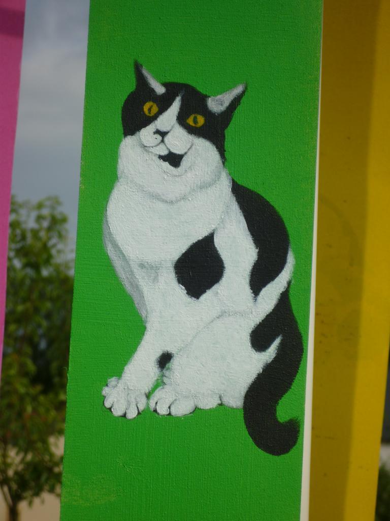 Petit chat sur fond vert ( tissu pour store )