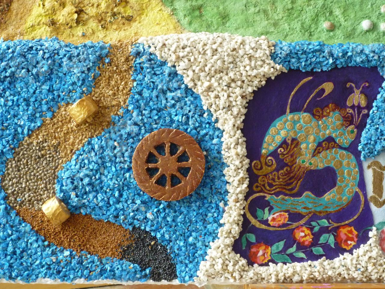 Roue à aube,meules,graines (cameline,lin,sarasin,tournesol),cailloux